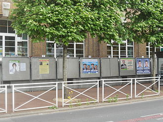 2012 French legislative election - Official campaign posters in the 5th constituency of Val-de-Marne. (One of the posters has been partly torn off: a not infrequent occurrence.)