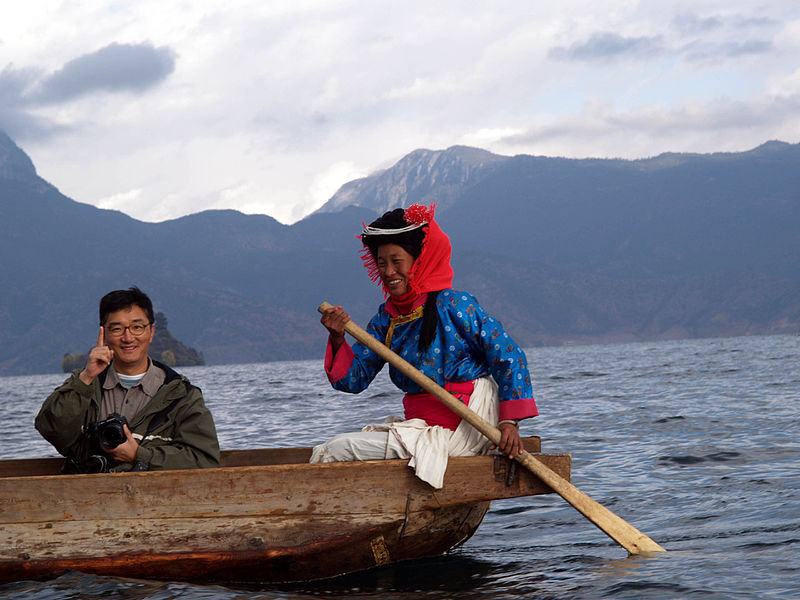 File:Lake Lugu With Moshui-Zu Woman.JPG