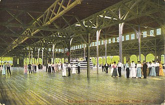 """Dance hall - A postcard from the early 20th century, showing the dance pavilion on Cedar Point, Ohio, built in 1882, and labelled """"The largest Dance Floor on Lake Erie""""."""