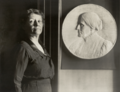 Leila Usher with bas-relief of Susan B. Anthony.png