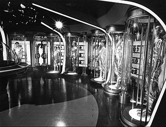 Suspended animation in fiction - A 1965 press photo of actors portraying the Robinson Family being placed in suspended animation for their space voyage, in Lost in Space.