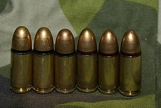 9×19mm Parabellum - 9mm live ammunition m/39 (left, with black seal) and m/39B (right, with red seal and a slightly more pointed shape)