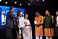 Manish Tewari and the Hollywood actress Michelle Yeoh presenting the Special Centenary Silver Peacock Award to Kamaleshwar Mukherjee.jpg
