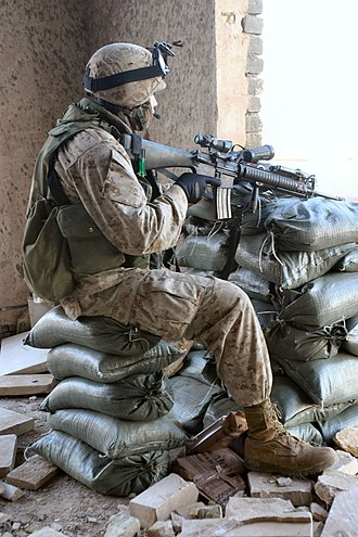 2nd Battalion, 5th Marines - A Marine of F/2/5 stands watch in Ramadi, Iraq in February 2005