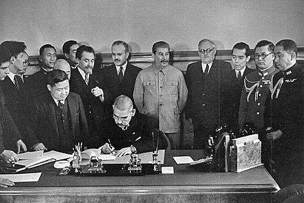 Stalin and Molotov on the signing of the Soviet-Japanese Neutrality Pact with the Empire of Japan, 1941 Matsuoka signs the Soviet-Japanese Neutrality Pact-1.jpg