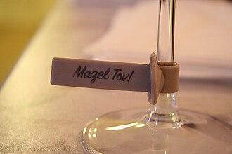 "Mazel tov - ""Mazel Tov!"" written on a wine glass tag"