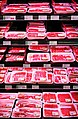 Meat under pink LED lighting in a meat refrigerator.jpg