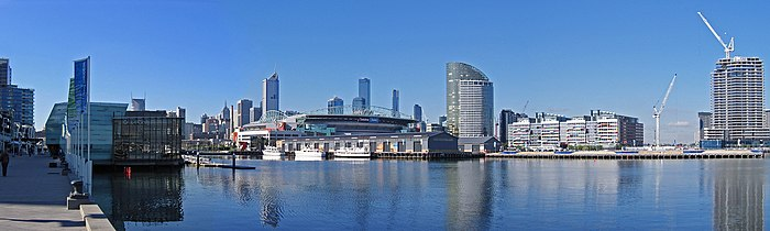 A panoramic view of the Melbourne Docklands and the city skyline from Waterfront City, looking across Victoria Harbour.