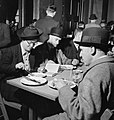 Members of the public enjoying a meal at the Londoners' Meals Service canteen at Fishmongers' Hall, London, 12 October 1942. D10505.jpg