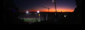 Tightwad Hill - Panoramic view from Tightwad Hill at sunset showing a match against USC.