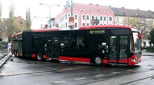 Public transport in Bratislava - A bus leaving a bus stop in Bratislava