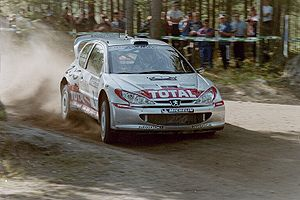 Marcus Grönholm - Grönholm driving a Peugeot 206 WRC at the 2001 Rally Finland.