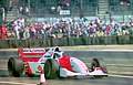 Mika Hakkinen - Mclaren MP4-9 leaves the pits at the 1994 British Grand Prix (32388771332).jpg
