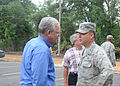 Missouri Gov. Jay Nixon, left, speaks with U.S. Air Force Brig. Gen. David Newman, the chief of the joint staff of the Missouri National Guard, about the Guard's assistance with flood relief efforts Aug. 8 130808-F-DT605-009.jpg