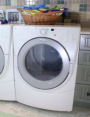 Clothes dryer - A modern front-load tumble clothes dryer for home application