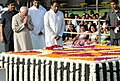 Mohd. Hamid Ansari paying homage at the Samadhi of Mahatma Gandhi on his 142nd birth anniversary, at Rajghat, in Delhi on October 02, 2011. The Union Minister for Urban Development, Shri Kamal Nath is also seen.jpg