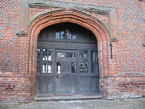 Tudor architecture - Doorway to Layer Marney Tower, showing the distinctive low Tudor arch and patterns in the brickwork.