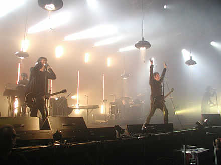 Nine Inch Nails during the Performance 2007 tour. From left to right: (Front) Jeordie White, Trent Reznor, Aaron North, (Back) Alessandro Cortini, Josh Freese NIN Munich 2007.jpg