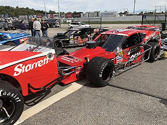 NASCAR Whelen Modified Tour - 2018 7NY from Tommy Baldwin Jr. line up in the Garage before the Musket 250 at New Hampshire Motor Speedway.