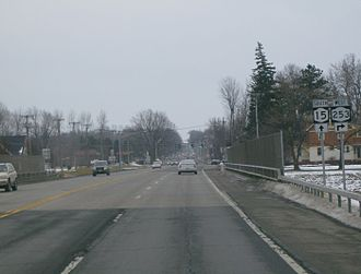 New York State Route 15 - Southbound on the NY 15 / NY 253 overlap in Henrietta. NY 253 leaves NY 15 in the near foreground; off in the distance is West Henrietta.