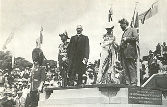 The ceremony for the naming of Canberra, 12 March 1913. Prime Minister Andrew Fisher is standing, centre, in dark suit. To his right is the Governor-General, Lord Denman, and to his left, Lady Denman. Naming of city of canberra capital hill 1913.jpg