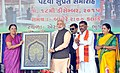 Narendra Modi being presented a memento by the Chief Minister of Gujarat, Smt. Anandiben Patel, at a function to hand over certificate to mark Shyamji Krishna Varma's posthumous reinstatement to bar, at Bhuj, in Gujarat.jpg