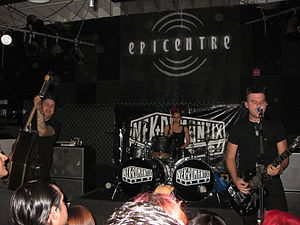 Nekromantix - Nekromantix performing in 2011. Left to right: Nekroman, Lux, and Mesa
