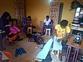 Nigerian youths working hard in making durable and beautiful bags with webbing to make a decent living.jpg