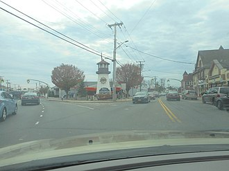 Oceanside, New York - Driving south toward the Liberty Lighthouse on the Veterans Triangle in Oceanside in November 2017.