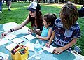 Ojai, Calif. (March 18, 2017) - Visitors color seed packets to hold native pollinator seeds during an event at the Libbey Bowl celebrating women in science, and longtime condor advocate Jan Hamber. (33175639120).jpg