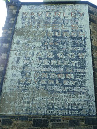 Abbeyhill Junction - Faded hotel advertisement on a tenement overlooking Abbeyhill Junction