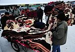 Operation Warm and Dry purchasing blankets & coats 120206-F-EY492-358.jpg