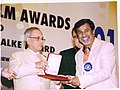 P. Sheshadri receiving the National Film Award for Best Feature Film in Kannada for December-1.jpg
