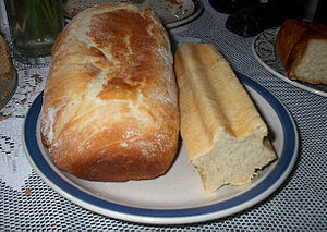Two loaves of pain de mie. The loaf at right w...