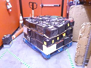 Battery recycling - Lead–acid batteries collected by an auto parts retailer for recycling.