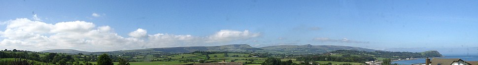 Panorama of the Antrim Plateau and Antrim Coast from the Blackcave area of Larne. From left to right (panning from West to North): Craigy Hill, Agnew's Hill, Sallagh Braes, Knock Dhu, Scawt Hill, Drains Bay, Ballygally Head, North Channel