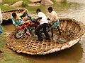Passengers Maneuver Motorcycle out of Reed Boat - Near Hampi - India.JPG