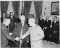 Paul Hoffman is sworn in as administrator of the European Recovery Corporation by Chief Justice Fred Vinson in the... - NARA - 199760.tif