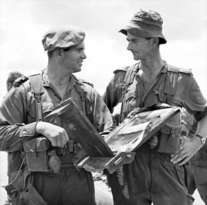 Peter Arnison - Captain Peter Arnison (left) and Major Ian McFarlane of the 1st Battalion, Royal Australian Regiment on their return from a battalion strength operation in Biên Hòa, Vietnam, in July 1965.