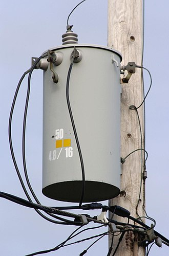 "Transformer - Pole-mounted distribution transformer with center-tapped secondary winding used to provide ""split-phase"" power for residential and light commercial service, which in North America is typically rated 120/240 V."