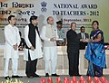 Pranab Mukherjee presenting the National Award for Teachers-2012 to Smt. Pilli Mercy Manjula, Andhra Pradesh, on the occasion of the 'Teachers Day', in New Delhi. The Union Minister for Human Resource Development.jpg
