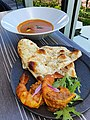 Prawn tandoori, sesame nan, goa coconut curry, at Tokvo Midtown.jpg