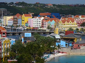 Queen Emma Bridge - The Queen Emma Bridge is the pontoon bridge in the center, with the colorful buildings of Willemstad in the background.