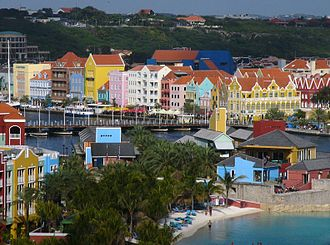 Otrobanda - Otrobanda and Rif Fort are in the foreground, while the Queen Emma Bridge is the pontoon bridge in the center, with the colorful buildings of Willemstad in the background.