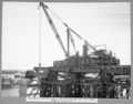 Queensland State Archives 3447 Main Bridge erection stage 2 erecting first section of east lower chord of anchor arm Brisbane 8 October 1937.png