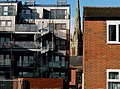 Quinny Crescent with flats on Moss Lane West and St Mary's church behind - Moss Side, Manchester - panoramio.jpg