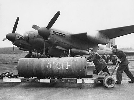 "A 4,000-lb HC bomb, marked ""Happy Xmas Adolf"" being loaded onto a de Havilland Mosquito of No. 128 Squadron RAF"