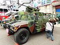ROCMC Petty Officer and Mother Help Child Climbing up Humvee 20140327.jpg