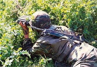 Rangefinder - Greek soldier using a laser rangefinder