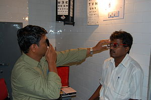Refractive error - A doctor uses a trial frame and trial lenses to measure the patient's refractive error.